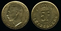 Coin of the former Luxembourg franc in two of the country's three languages: French (obverse, left) and Luxembourgish (reverse, right)