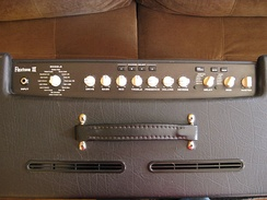 A Line 6 modeling amplifier shown from above. Note the various amplifier and speaker emulations selectable via the rotary knob on the left.