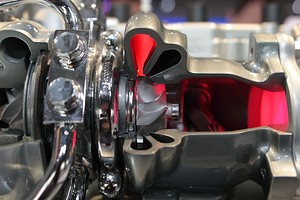 Cut-out of a twin-scroll turbocharger, with two differently angled nozzles
