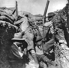 An Australian sniper aims a periscope-equipped rifle at Gallipoli in 1915. The spotter beside him is helping to find targets with his own periscope.