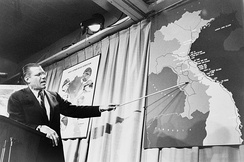 McNamara pointing to a map of Vietnam at a press conference in April 1965
