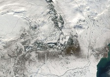 Satellite image of Romania in December, showing most of its territory under snow