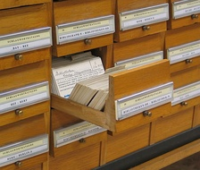 In the 2010s, metadata typically refers to digital forms, but traditional card catalogues contain metadata, with cards holding information about books in a library (author, title, subject, etc.).