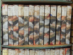 Shelf of Shakespeare plays hand-bound by Virginia Woolf in her bedroom at Monk's House[z]