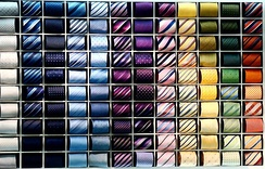 A collection of different colors of ties.