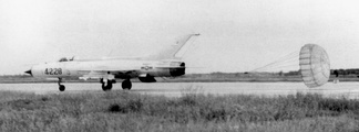 A missile-armed VPAF MiG-21PF landing, using its drogue parachute