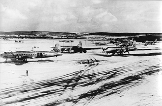 C-54s stand out against the snow at Wiesbaden Air Base during the Berlin Airlift in the Winter of 1948–49