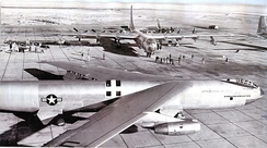 Prototype YB-52 bomber at Carswell AFB, c. 1955, shown with a 7th Bomb Wing B-36