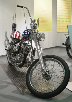 "Replica of the ""Captain America"" Harley-Davidson chopper which Fonda rode in Easy Rider (1969), on display in a German museum.[20]"