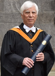 Bahram Beyzai, dressed in a traditional St. Andrews black cassock, having just received a D.Litt. honoris causa, June 2017