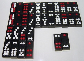 A set of Chinese dominoes. The top double-row of tiles lists the eleven matching pairs, in descending value from left to right. Below them are five non-matching pairs, worth less than the matching pairs, and also in descending value from left to right. The Gee Joon tiles, lower right, are the highest pair of all.