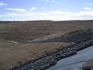 A landfill in México showing geomembrane in one of the slopes.