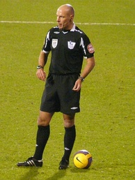 Referee Howard Webb wearing a black strip