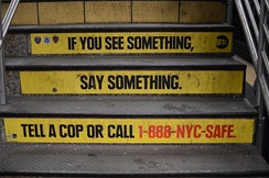 "Stairs in the Times Square–42nd Street station painted with the slogan, ""If you see something, say something."""