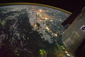 Clusters of yellow lights on the Indo-Gangetic Plain reveal numerous cities large and small in this astronaut photograph of northern India and northern Pakistan, seen from the northwest. The orange line is the India–Pakistan border.