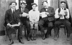 Keaton (center) in 1923, with (from left) writers Joe Mitchell, Clyde Bruckman, Jean Havez, and Eddie Cline