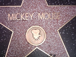 closeup of Mickey Mouse star, showing title and Motion Picture emblem