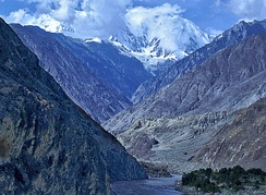 Gorge cut by the Indus river into bedrock, Nanga Parbat region, Pakistan. This is the deepest river canyon in the world. Nanga Parbat itself, the world's 9th highest mountain, is seen in the background.