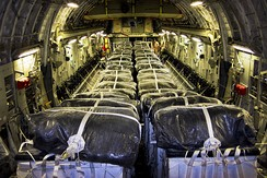Water is loaded on a U.S. C-17 for an airdrop on 8 August.