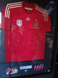 Autographed jersey of the Spain national football team that was manufactured by Adidas for the 2014 FIFA World Cup