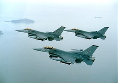 Three 36th Fighter Squadron F-16Cs in flight.