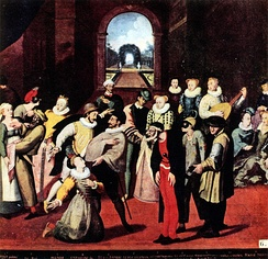 "A scene from the commedia dell'arte played in France before a noble audience in 1571 or 1572 (Museum of Bayeux). Pantalone is front and center, while just to the right and slightly behind is Harlequin in motley costume, ""the oldest known version of Harlequin's costume.""[13][14]"
