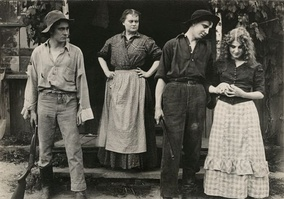 Scene of Lawrence (far right) in the 1912 Victor production After All. Other cast include (from left) Owen Moore, Victory Bateman on step, and Gladden James.