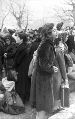 A young woman weeps during the deportation of Jews of Ioannina  (Greece) on 25 March 1944.