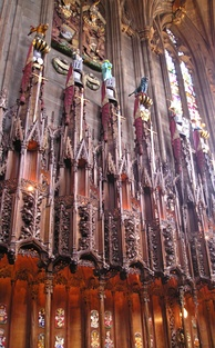 Swords, helms and crests of Knights of the Thistle above their stalls in the Thistle Chapel. Lady Marion Fraser's helm and crest are second from the left