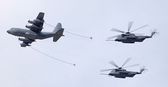 A MC-130W refuels two MH-53J Pave Lows during an air demonstration ceremony over Hurlburt Field, Fla.