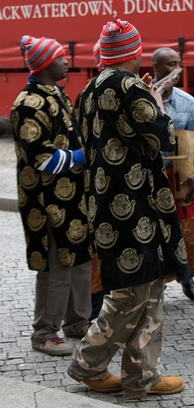 Men wearing contemporary Isiagu with the ceremonial Igbo men's hat okpu agu
