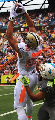"At 6'7"", 265 lbs., tight end Jimmy Graham, shown here playing for the New Orleans Saints, demonstrates the athleticism successful tight ends need in catching the ball"