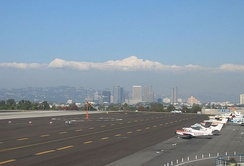 Landing craft at Santa Monica Airport. Looking east towards Century City