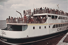 Tourists aboard a Circle Line ferry arriving at Liberty Island, June 1973