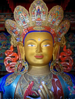 Close-up of a statue depicting Maitreya at the Thikse Monastery in Ladakh, India. Depictions of Maitreya vary among Buddhist sects.