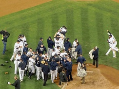 New York Yankees celebrate after their 7–3 win against the Philadelphia Phillies and win the franchise's 27th World Series championship.