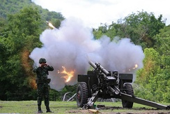 Royal Thai Army firing extended range ammunition from M101 modified with LG1 L/33 cal barrel.
