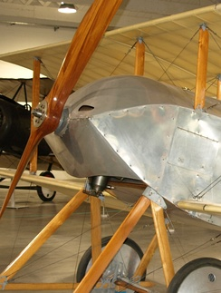 The Sopwith Tabloid reproduction shows the sheet-metal cowling used to redirect the oil sprayed by the rotating engine.