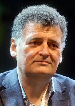 "Then-head writer and showrunner Steven Moffat (pictured) wrote ""The Day of the Doctor"", which he stated would ""change the narrative"" of Doctor Who.[43]"