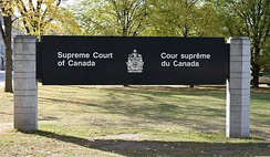 Signage for the supreme court in French and English. Either language may be used in federal courts.