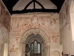 In England the major pictorial theme occurs above the chancel arch in parish churches. St John the Baptist, Clayton, Sussex