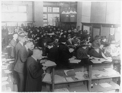 People filing tax forms in 1920.