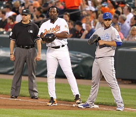 Hosmer playing in position with Vladimir Guerrero on first during a game against the Baltimore Orioles