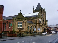 The facade of Ashton town library, constructed from stone and built in Gothic revival style