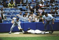 Rickey Henderson—the major leagues' all-time leader in runs and stolen bases—stealing third base in a 1988 game