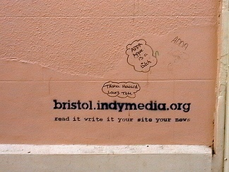 "Graffito in Bristol, United Kingdom advertising the local chapter of Indymedia with the slogan ""Read it, write it, your site, your news"""
