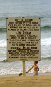 "Durban beach sign in English, Afrikaans and Zulu, declaring the beach ""Whites Only"""