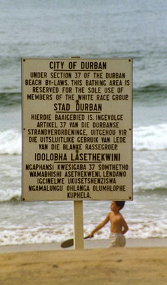"A sign on a racially segregated beach during the Apartheid era in South Africa, stating that the area is for the ""sole use of members of the white race group"""