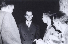 Feynman (center) with Robert Oppenheimer (immediately right of Feynman) at a Los Alamos Laboratory social function during the Manhattan Project