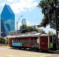 McKinney Avenue trolley, with the I.M. Pei-designed Fountain Place in the background.
